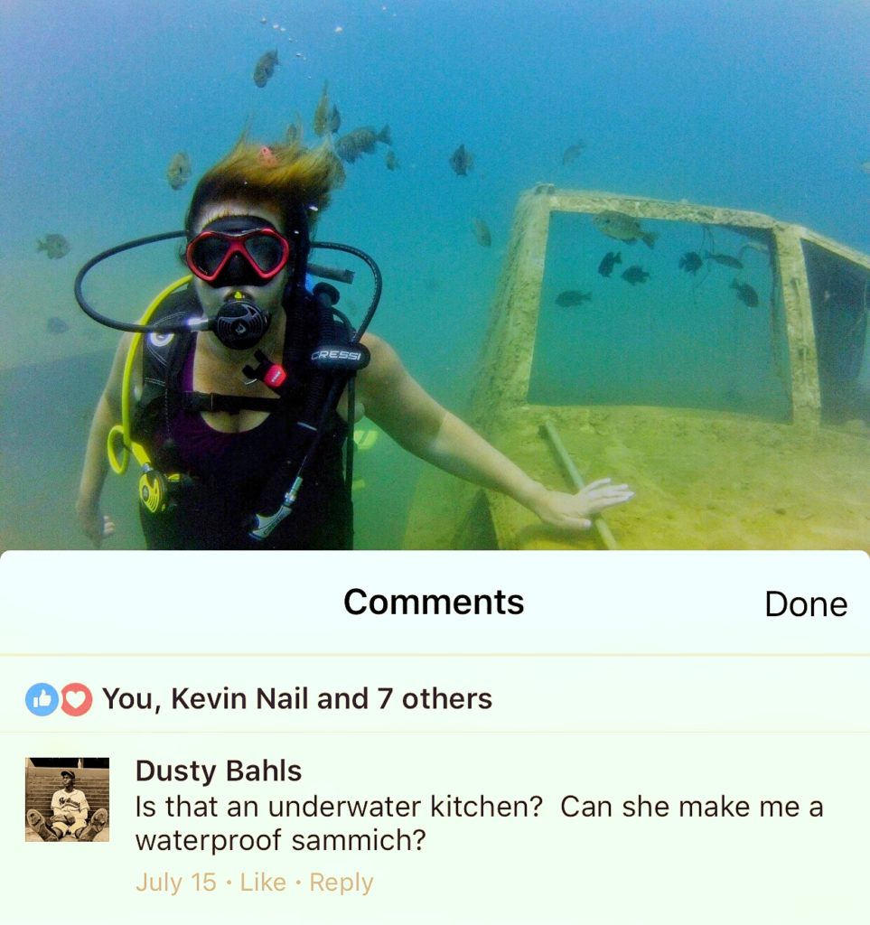 Woman Scuba Diving with Comment