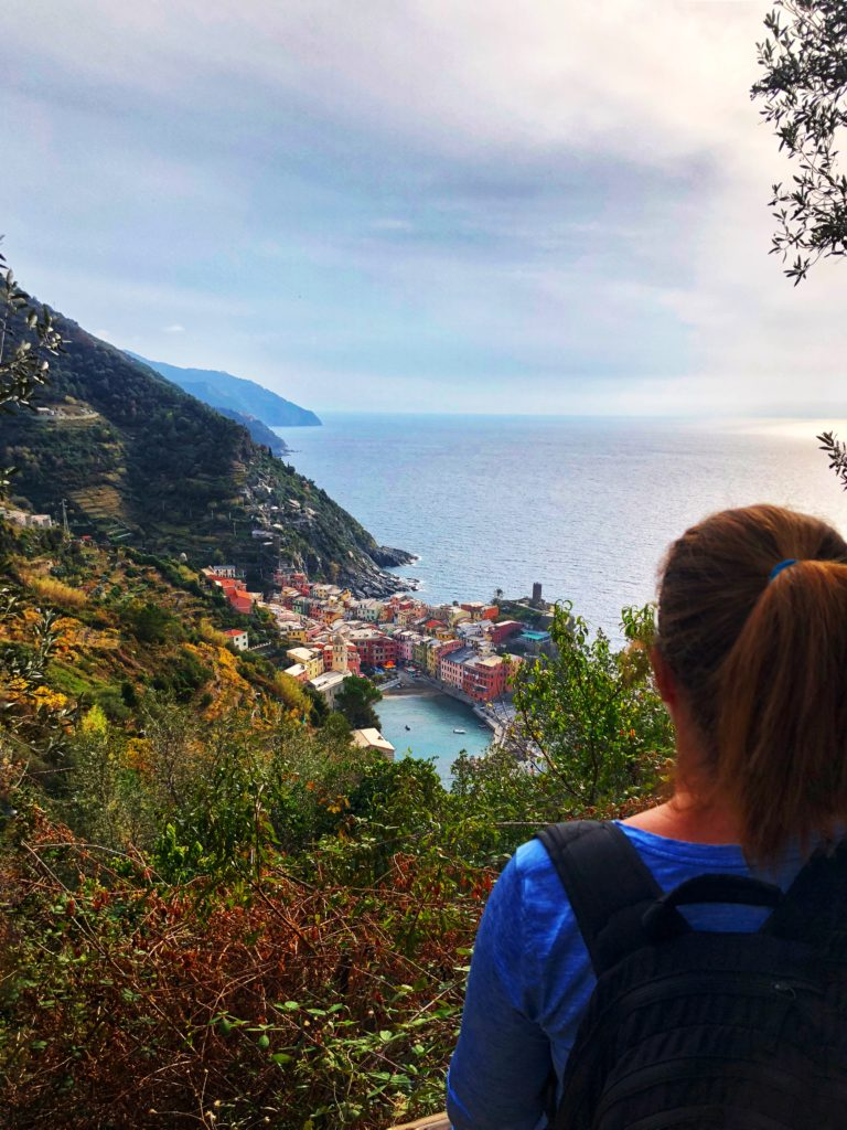 Woman looking at Vernazza, Italy for trail at Cinque Terre