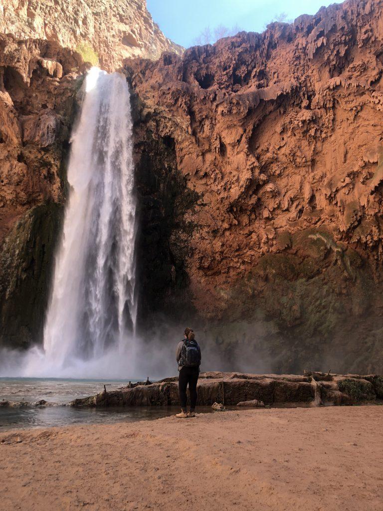 Author looking up at Mooney Falls in Havasupai